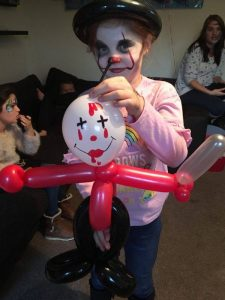 It the clown face painting and killer clown balloon model.