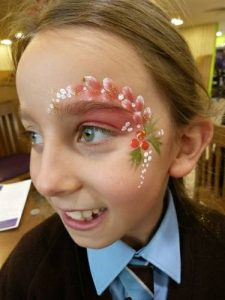 Christmas face painting at a Christmas market in Stow-on-the-wold