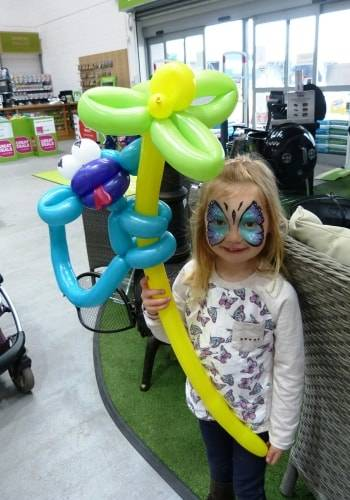 Child holding a monkey balloon model at an event in Bristol.