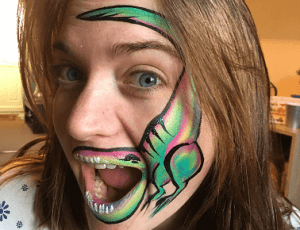 Dinosaur face painting.