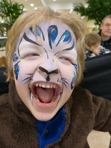 Blue tiger face painting.