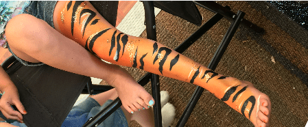 Tiger leg body painting at a children's festival in Cirencester.