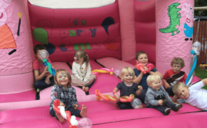 Peppa pig bouncy castle and balloon modelling.