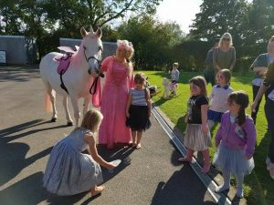 Kate leading a unicorn party at a children's party in Cheltenham.