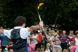Kai juggling with fire at an event in Gloucester.