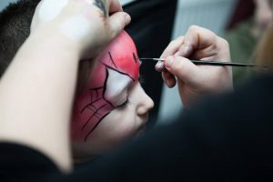Face painting Spiderman at an event in Gloucester.