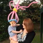 Princess poppy balloon model hat and face painting at a company event in Stroud, Glos.